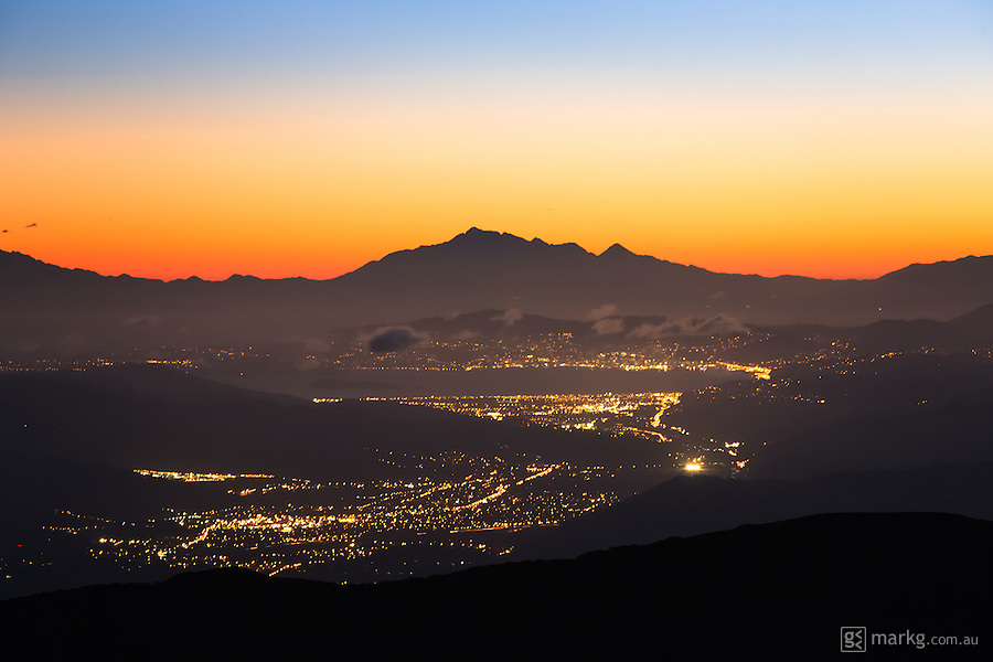 The lights of Wellington, New Zealand on a perfectly clear evening just after sunset. In the foreground you can see the lights of Upper and Lower Hutt with Wellington situated on the other side of the harbour. The mountains in the background are the Kaikoura Ranges on the South Island, with Cook Strait being the body of water separating the North and South Islands. This image was photographed from the Tararua Ranges approximately 1300m above sea level.