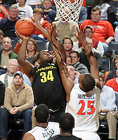 Dec. 17, 2010; Charlottesville, VA, USA; Oregon Ducks forward Joevan Catron (34) shoots the ball in front of Virginia Cavaliers forward Akil Mitchell (25) during the game at the John Paul Jones Arena. Virginia won 63-48. Mandatory Credit: Andrew Shurtlef