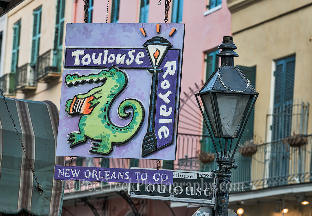 Neon Street signs day from New Orleans French Quarter.