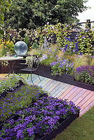 Fantastic color themed purple, lavender, blue garden with rainbow walkway, gazing ball