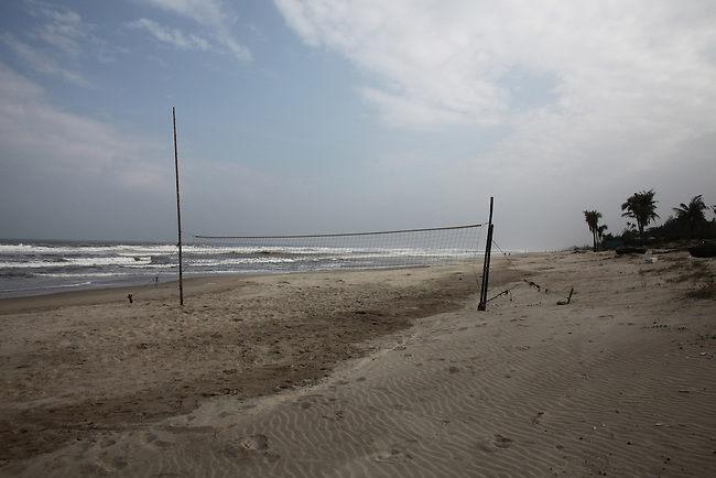 A volleyball net sits on the beach near Hoa's Place guesthouse south of Da Nang, Vietnam. Dec. 25, 2012.
