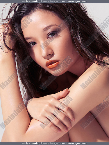 Sensual portrait of a young asian woman beautiful face with long wet hair