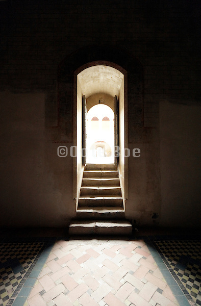 door opening with stairs and tiled flooring seen from inside