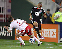 Charlie Davies (9) of D.C. United clashes with Teemu Tainio (2) of the New York Red Bulls during an MLS match at RFK Stadium, in Washington D.C. on April 21 2011. Red Bulls won 4-0.