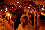 Israel, Jerusalem Old City, Ethiopian Orthodox procession around the dome of Deir es Sultan at the Church of the Holy Sepulchre on Holy Saturday, Easter, 2006<br />