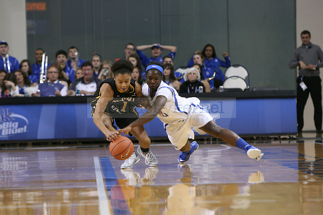 UK guard Linnae Harper goes for the steal against NKU forward Faith Sanders at the University of Kentucky versus Northern Kentucky University women's basketball game at Memorial Coliseum in Lexington, Ky., on Wednesday, December 3, 2014. Photo by Cameron Sadler | Staff