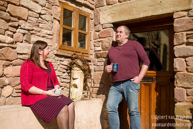 Sue and Andrew Clarke enjoy a cup of tea at their home near St. Briavels.