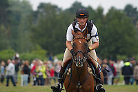 Frank Ostholt (GER) and Air Jordan during the cross country. FEI Eventing CIC*** at Malmo City Horse Show 2010. The couple was placed 5th after Friday's dressage, but retired during Saturday's cross country (this pic).<br /> Eventing in Ribersborg, Malmo, Sweden.<br /> August 2010.<br /> Only for editorial use.<br /> Note to buyers: rider slightly out of focus.