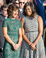 First lady Michelle Obama shares conversation with Mrs. Agnese Landini of Italy during an Official Arrival Ceremony in honor of the visit of Prime Minister Matteo Renzi of Italy on the South Lawn of the the White House in Washington, DC on Tuesday, October 18, 2016. <br /> Credit: Ron Sachs / CNP /MediaPunch