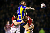 Picture by Alex Whitehead/SWpix.com - 09/03/2017 - Rugby League - Betfred Super League - Warrington Wolves v Wigan Warriors - Halliwell Jones Stadium, Warrington, England - Warrington's Ashton Sims is tackled by Wigan's Ben Flower and Sam Powell.