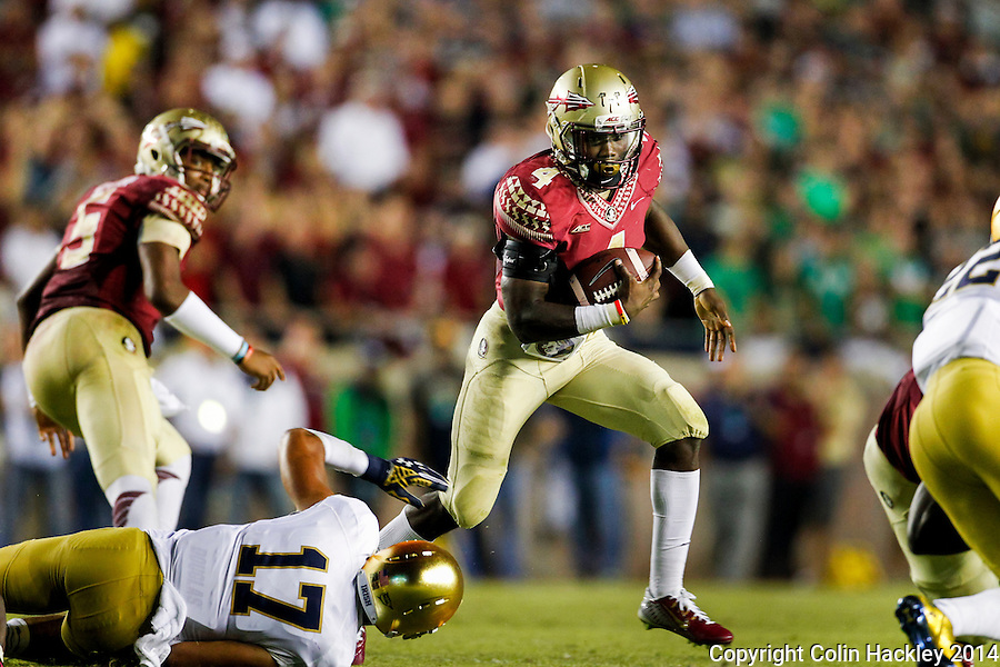 TALLAHASSEE, FLA. 10/18/14-FSU-ND101814CH-Florida State's Dalvin Cook runs to a gap in the Notre Dame line during second first half action Saturday at Doak Campbell Stadium in Tallahassee. The Seminoles beat the Fighting Irish 31-27.<br /> COLIN HACKLEY PHOTO