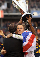 CARSON, CA - DECEMBER 01, 2012:   David Beckham (23) of the Los Angeles Galaxy with Bruce Arena after beating the Houston Dynamo during the 2012 MLS Cup at the Home Depot Center, in Carson, California on December 01, 2012. The Galaxy won 3-1.