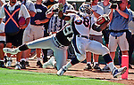Oakland Raiders vs. Denver Broncos at Oakland Alameda County Coliseum Sunday, September 17, 2000.  Broncos beat Raiders  33-24.  Oakland Raiders defensive end Regan Upshaw (91) tackles Denver Broncos running back Mike Anderson (38).