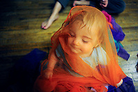 MITO HABE-EVANS/Missourian 510.333.7615.Eleven-and-a-half-month-old Hannah Cox (cq), sitting in a nest of multicolored scarves, slowly pulls one over her head as music plays in the Kindermusik studio at Parkade Plaza on Tuesday, October 6, 2009.