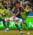 Seattle Sounders Brad Evans (3) defends New England Revolution  Juan Agudelo (17)during an MLS match on March 8, 2015 in Seattle, Washington.  The Sounders beat the Revolution 3-0.  Jim Bryant Photo. ©2015. All Rights Reserved.