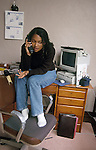 Oakland CA Girl, sixteen-years-old chatting with friend on phone in her bedroom  MR