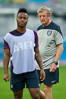 England manager Roy Hodgson and Raheem Sterling during training
