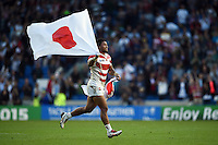 Amanaki Mafi of Japan celebrates the win after the final whistle. Rugby World Cup Pool B match between South Africa and Japan on September 19, 2015 at the Brighton Community Stadium in Brighton, England. Photo by: Patrick Khachfe / Onside Images