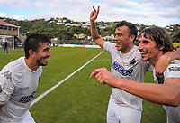 Emiliano Tade (left), Clayton Lewis and Albert Riera celebrate victory after the Oceania Football Championship final (second leg) football match between Team Wellington and Auckland City FC at David Farrington Park in Wellington, New Zealand on Sunday, 7 May 2017. Photo: Dave Lintott / lintottphoto.co.nz