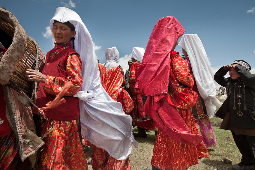 Kyrgyz women during a wedding celebration in the Afghan Pamir - camp of Kitshiq Aq Jyrga...Trekking through the high altitude plateau of the Little Pamir mountains (average 4200 meters) , where the Afghan Kyrgyz community live all year, on the borders of China, Tajikistan and Pakistan.