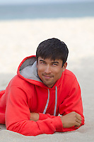 Handsome Asian American Man outdoors at the beach