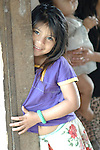 Smiling girl in her home in traditional Mayan village of Midway, in southen Belize.