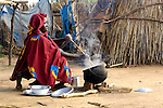 Fatna cooks a meal for her family in a camp for internally displaced persons outside Kubum, in South Darfur, where international aid agencies are providing water, sanitation and other emergency services. Since 2003, more than 2.5 million people have been displaced in Darfur, and some 400,000 have died in what many consider to be the world's worst humanitarian disaster.