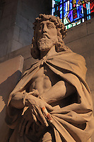 Stone statue of Christ with hands bound and wearing a crown of thorns, Ecce Homo, 185cm high, 17th century, listed as a protected object, in the Collegiale Notre-Dame de Poissy, a catholic parish church founded c. 1016 by Robert the Pious and rebuilt 1130-60 in late Romanesque and early Gothic styles, in Poissy, Yvelines, France. Saint Louis was baptised here in 1214. The Collegiate Church of Our Lady of Poissy was listed as a Historic Monument in 1840 and has been restored by Eugene Viollet-le-Duc. Picture by Manuel Cohen