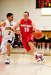 21 January 2010: Stony Brook University Seawolves' guard Bryan Dougher, a Sophomore from Scotch Plains, NJ, drives against the University of Vermont Catamounts at Patrick Gymnasium in Burlington, Vermont. The Catamounts fell to the Seawolves 65-60 in the America East matchup. Mandatory Credit: Ed Wolfstein Photo