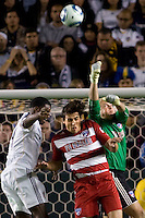 FC Dallas goalkeeper Kevin Hartman (green) punched the ball clear past teammate George John (red) and LA Galaxy forward Edson Buddle (white). FC Dallas defeated the LA Galaxy 3-0 to win the Western Division 2010 MLS Championship at Home Depot Center stadium in Carson, California on Sunday November 14, 2010.