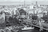 Birds eye view of Charing Cross railway station, Hungerford Bridge, and Golden Jubilee Bridges from the London Eye on the South Bank of the Thames, London, England