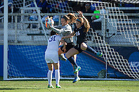 Cary, North Carolina - Sunday December 6, 2015: Duke Blue Devils goalie EJ Proctor (30) makes a save between teammate Christina Gibbons (31) and Mallory Weber (16) of the Penn State Nittany Lions during second half action at the 2015 NCAA Women's College Cup at WakeMed Soccer Park.  The Nittany Lions defeated the Blue Devils 1-0.