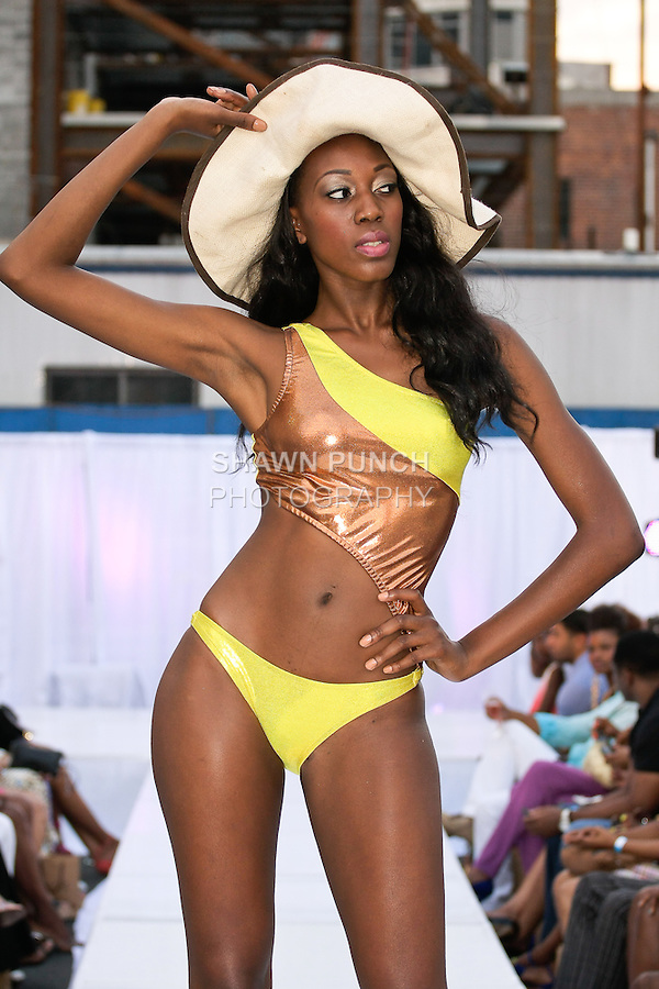 Model walks runway in a Cole Facts swimsuit from the CF Swim 2012 collection by Michelle Cole, during the JRG Bikini Under The Bridge 2012 fashion show on July 9, 2012.