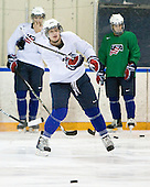 John Carlson (USA - 11) - Team USA practiced at the Agriplace rink on Monday, December 28, 2009, in Saskatoon, Saskatchewan, during the 2010 World Juniors tournament.