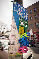 A homemade 3d printed recycling bin in the Bushwick neighborhood of Brooklyn in New York on Saturday, April 19, 2014. The neighborhood is undergoing gentrification changing from a rough and tumble mix of Hispanic and industrial to a haven for hipsters, forcing many of the long-time residents out because of rising rents.. (© Richard B. Levine)