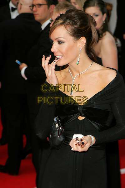 TARA PALMER-TOMKINSON.Red Carpet Arrivals at The British Academy Television Awards (BAFTA's) Sponsored by Pioneer, held at the London Palladium, London, England, May 20th 2007. .half length black TPT Palmer Tomkinson mouth hand putting on applying make-up lip gloss.CAP/AH.©Adam Houghton/Capital Pictures.