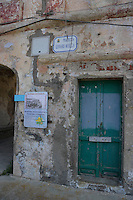 Isola di Pianosa. Pianosa Island. .Le targhe stradali dedicate ai morti ammazzati dalla mafia..The street signs dedicated to the dead killed by the Mafia..Piazzetta Gennaro Musella...