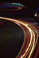 DAYTONA BEACH, FL - FEBRUARY 3: A time-exposure photograph illustrating streaks of taillights and turbocharger flames during the 1985 24 Hours of Daytona IMSA GT race at the Daytona International Speedway in Daytona Beach, Florida, on February 3, 1985.