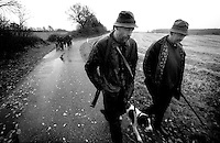 Farmers walking on the road to the next hunting place in the countryside of the Danish island Funen on sunday  17. November 2002.  Photo: Erik Luntang