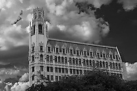 Architect Ralph Cameron designed the 13-story tower of reinforced concrete with glazed terra cotta at the three lower and three upper stories. The building's distinctive form and ornamentation are influenced by the Gothic revival that was the fashionable mode for skyscrapers nationwide in the 1920s. Sky replacement in this black & white conversion.