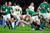 Dan Cole of England is tackled to ground. RBS Six Nations match between England and Ireland on February 27, 2016 at Twickenham Stadium in London, England. Photo by: Patrick Khachfe / Onside Images