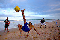 Children play football on Boa Viagem beach in Recife, Brazil, one of the 12 host cities of the 2014 FIFA World Cup