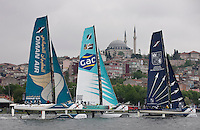 Extreme Sailing Series 2011. Act 3.Turkey . Istanbul.Oman Air Skippered by Sidney Gavignet , Team GAC Pindar skippered by Ian Williams and Groupe Edmond De Rothschild skippered by Pierre Pennec.Credit Lloyd Images