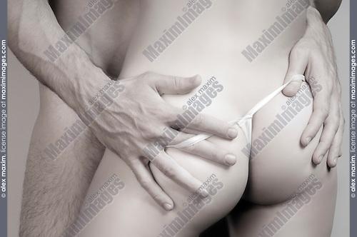 Closeup of man hands on woman buttocks