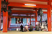 Torii, a traditional Japanese gate, at Itsukushima Shrine, a Ryobu-style torri. Miyajima Island, Hiroshima.