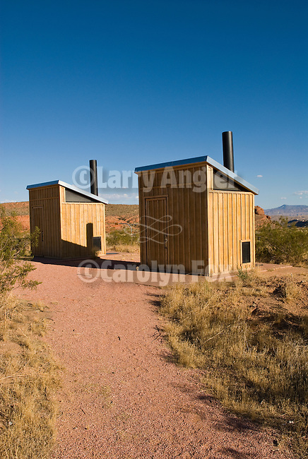 Two modern wooden outhouses in the red rock desert country, Utah