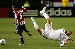 The Los Angeles Galaxy's DAVID BECKHAM flies through the air after a collision