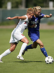 Lindsay Vera (l), of NC State, and Duke's Kelly McCann (r) challenge for the ball on Sunday October 2nd, 2005 at SAS Stadium in Cary, North Carolina. The Duke University Blue Devils defeated the North Carolina State University Wolfpack 1-0 during an Atlantic Coast Conference women's soccer game.