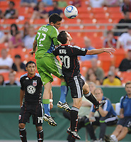Seattle Sounders midfielder Mike Seamon (22) head the ball against DC United midfielder Stephen King (20).  Seattle Sounders. defeated DC United 1-0 at RFK Stadium, Thursday July 15, 2010.