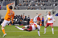 Thierry Henry (14) of the New York Red Bulls attempts a shot  during the first half against the Houston Dynamo. The New York Red Bulls  and the Houston Dynamo played to a 1-1 tie during a Major League Soccer (MLS) match at Red Bull Arena in Harrison, NJ, on April 02, 2011.